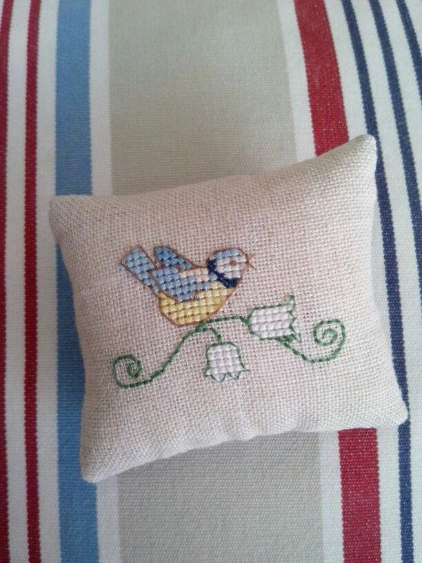 Cross stitched tiny tweet.