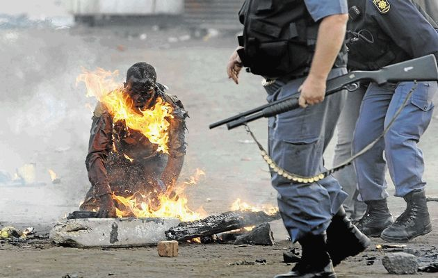 Nhamuave after police doused the flames consuming his body. Sixty-two people died during the wave of xenophobic attacks in 2008, an orgy of violence directed at foreigners. SA's xenophobia shame: 'burning man' case shut - Times LIVE