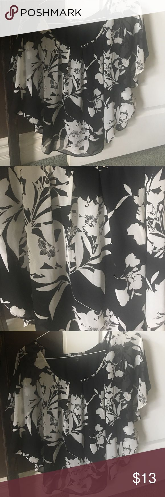 Batwing top Super cute batwing top black and white floral, it's a polyester type fabric! There's a black built in tank underneath Express Tops Tunics