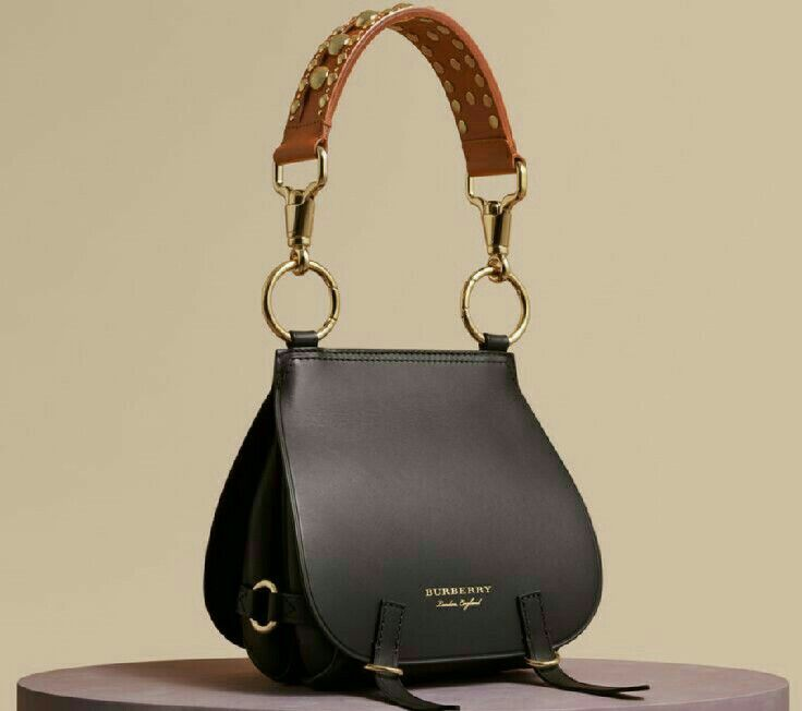 An Equestrian Inspired Runway Satchel In Smooth Bridle And Grainy Leathers From Burberry Reflecting Traditional British Saddlery The Soft Practical Shape