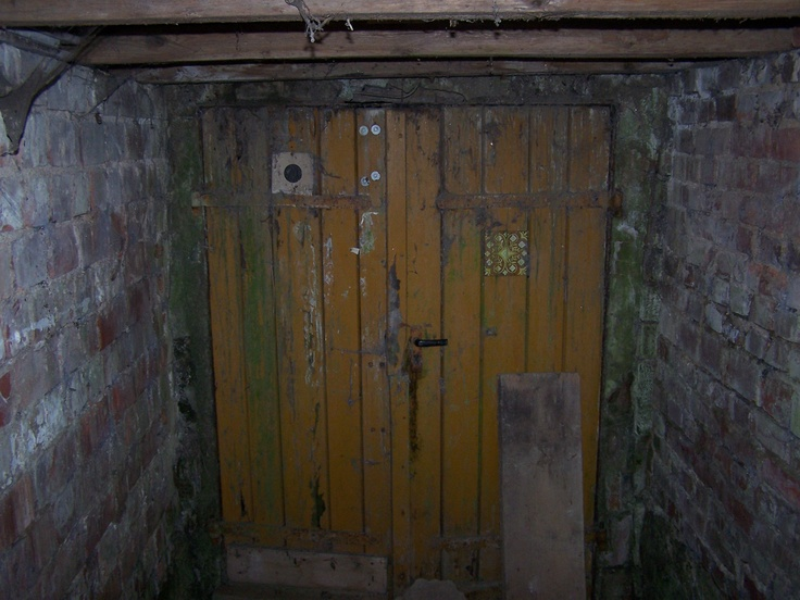 The door to the cellar where Christine & Isaac meet, later used as a bomb shelter.
