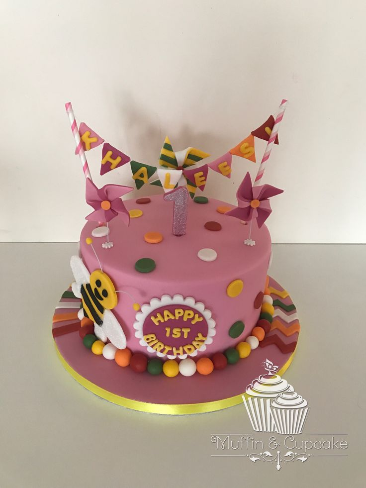 Pretty pink windmill cake with bumble bee and bunting
