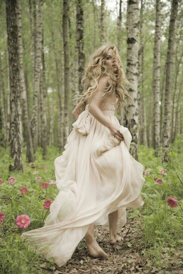 The dress Is o.k. but i love the photo idea. I would like to see both the bride and groom running thru the forest together with smiles and love in there eyes. ( in this particular pic it looks like the bride got cold feet and is running from the wedding)