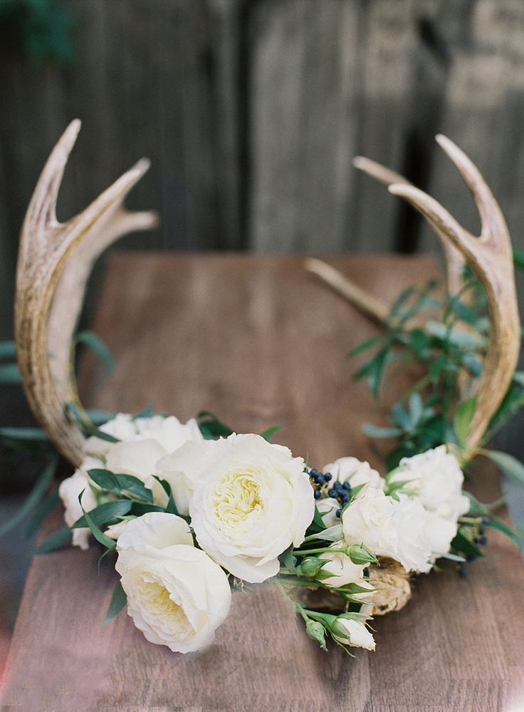 Floral antlers combine rustic beauty and your favorite flowers. You're the bride — so pick what you love most! Photo by Loblee Photography via Style Me Pretty