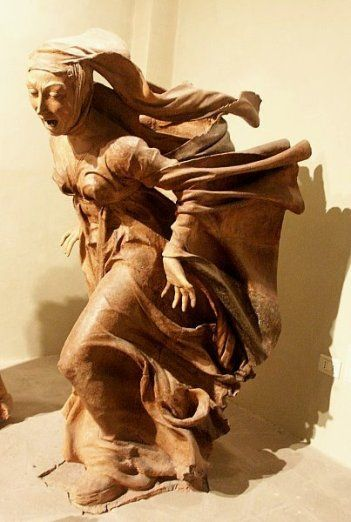 Mary Magdalene running to the disciples to tell them Jesus has risen, Niccolo del Arca, wooden carving, 1462