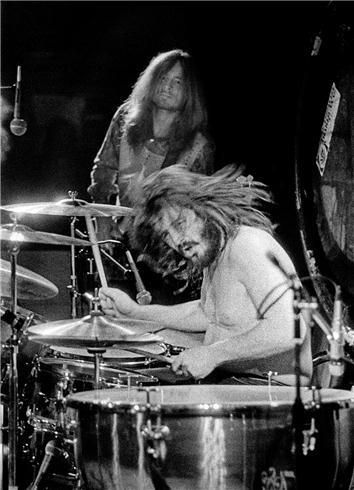 """John Bonham (1948-1980) English musician and songwriter, drummer of Led Zeppelin esteemed for speed, power, fast bass-drumming, distinctive sound, and """"feel"""" for the groove. began learning to play at 5 on containers and coffee tins, given a snare drum at 10, and his first drum kit at 15. His drum solos often lasted 30 minutes"""