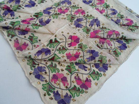 Late-Ottoman napkin. Early 20th century. Or possibly a 'yazma' or 'yemeni' (large head scarf).  This is 'two-sided embroidery' (front and rear are identical).