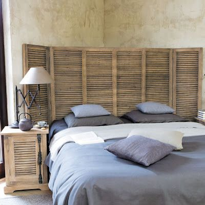 use louvered shutters to create a flat headboard-good if want to place bed in a corner and avoid awkward space / BOISERIE & C.