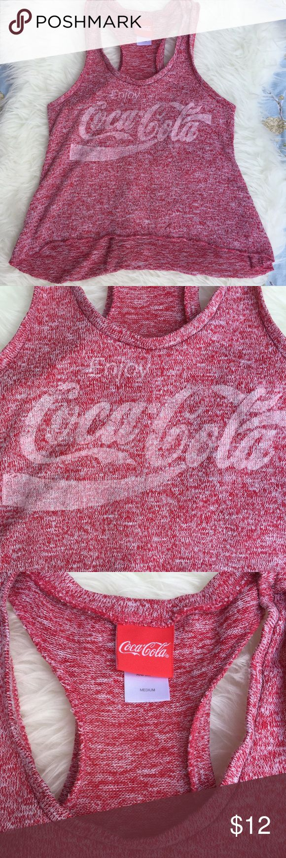 "Coca Cola racerback tank red & white knit Coca-Cola racerback tank top in red and white knit material. 55% rayon 43% polyester 2% spandex. Super cute with cut off's or jeans. Could also be adorable as a Halloween costume and your date could go as Jack Daniels in a Jack Daniels t-shirt. Approximate measurements: 🌹Bust: 16.5"" 🌹Length: 20"" front, 22"" back. Coca Cola Tops Tank Tops"