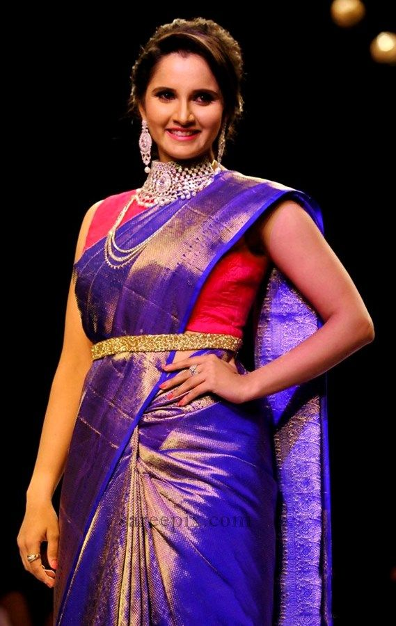 Indian tennis player Sania mirza saree ramp walk photos at IIJW 2015. She wore blue silk saree paired with boat neck blouse. Jewellery and waist belt added