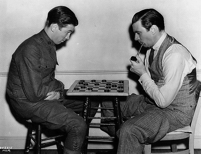 ames Stewart and Walter Pidgeon play checkers in a break from filming The Shopworn Angel 1938