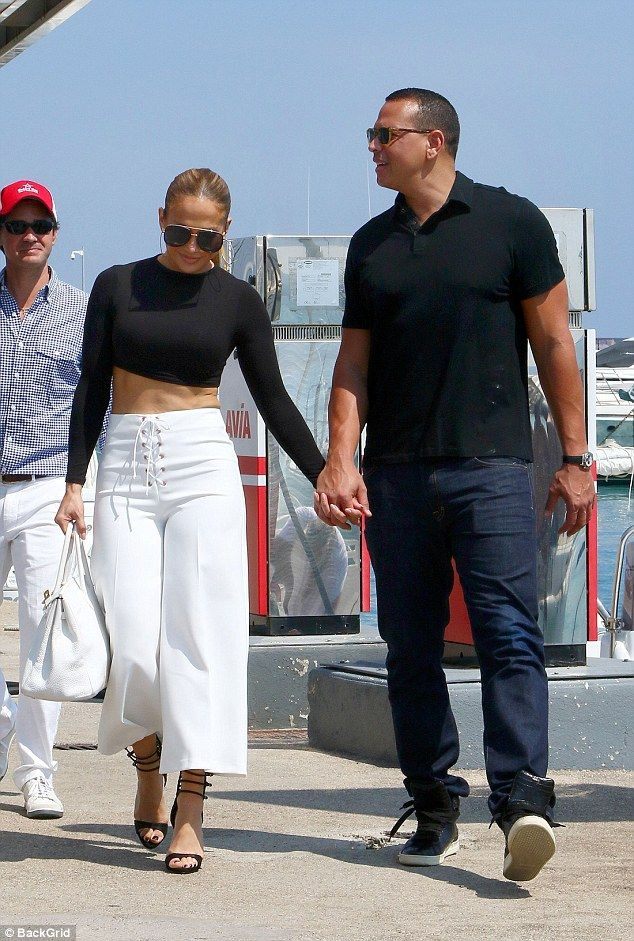 Fighting fit: Jennifer Lopez showed off her rock hard abs in a black crop top and white cu...
