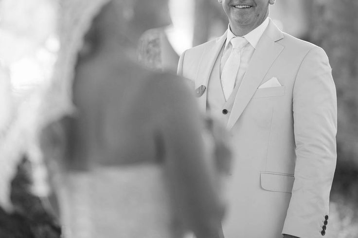 "Matt wears a 3 piece made to measure suit in Holland and Sherry ""Cotton Classics"" with a white shirt and ivory tie. Cathy's gown is by Astra Bridal, Wellington. Matt was assisted by Rob in our Wellington store. Photo: @niorphotography"