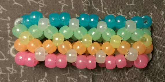Check out this item in my Etsy shop https://www.etsy.com/listing/247264720/x-base-kandi-cuff-rainbow-glow-in-the