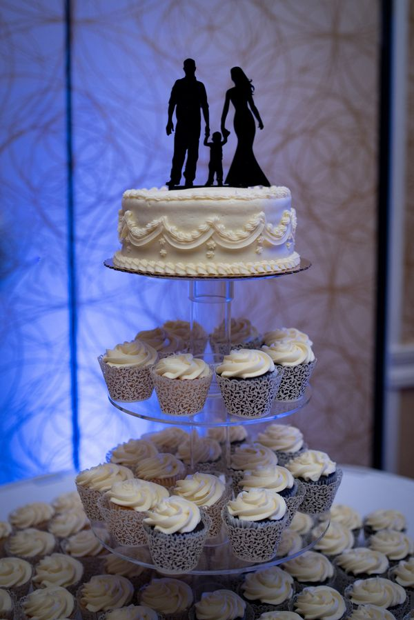 Love how this bride and groom included their son in their cake topper!