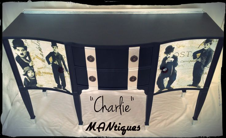 """""""Charlie""""   Large Curved 2 Drawer 2 Door 6 Legs Server  We started by painting the entire Server black and then got a little creative with the silver leafing on the drawer fronts, backsplash and leg caps. The 2 doors have had a Charlie Chaplin theme infused into their fronts and finished off with a stunning set of antique hand made glass handles.  Dimensions: 1,52m (L) by 54cm (W) and 92cm (H)"""