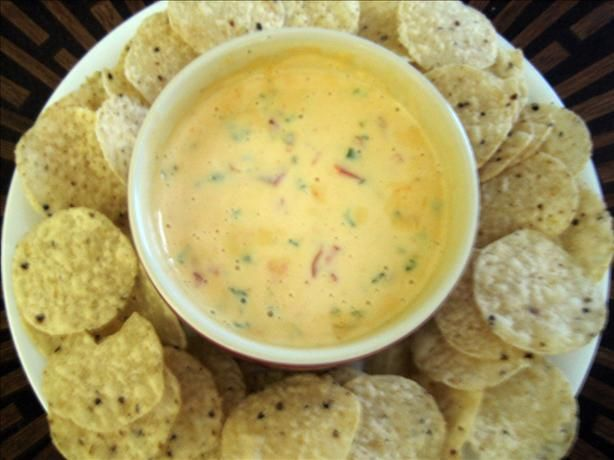 Just had this queso at a 4th of July party made by my fabulous cheese afficiando coworker and it was amazing.  Texas Best Cheese Dip (Chile Con Queso). Photo by Junebug