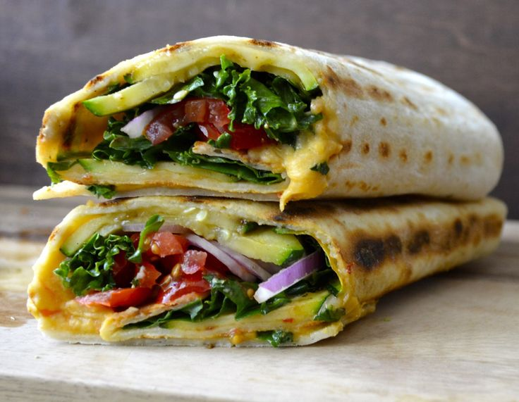 Grilled Zucchini Wrap: grilled zucchini tomatoes red onions kale sliced cheese tortilla and hummus
