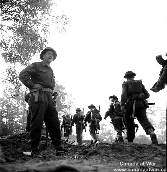 Canadians capture Caen - The North Nova Scotia Highlanders near the crossing of the Orne River, Normandy, 18 July 1944.