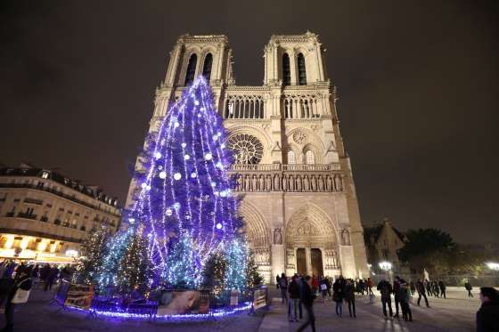 FRANCE   A giant Christmas tree is seen in the square in front of the Notre-Dame Cathedral in Paris, France, on December 2, 2017   photo: Ludovic Marin/AFP/Getty Images