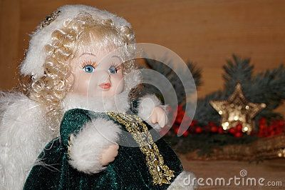 Beautiful angel on a Christmas background  The doll is bought from the supermarket