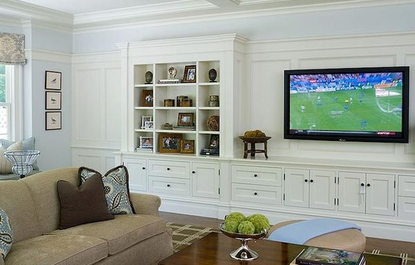 living rooms - wall media unit built-in cabinets shelves microfiber sand sofa blue brown pillows blue walls paint color living room TV built-ins