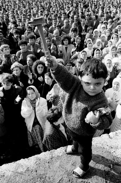 A group of 70,000 miners gather in Turkey to protest about their salaries. A young boy is in the foreground, captivating the crowd.