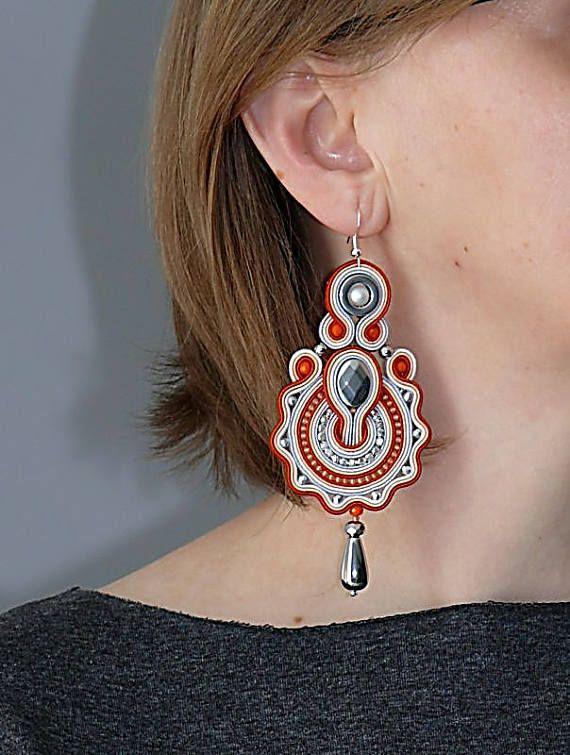 Arancione orecchini d'argento con ematite.