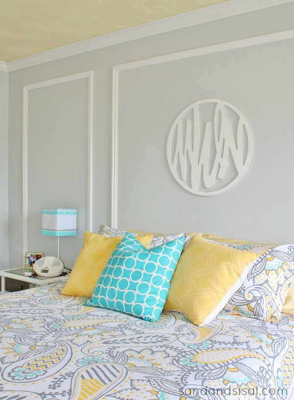 Teen Room Makeover - Come see the amazing makeover this teen bedroom went through. It has a fun and chic color scheme of gray, yellow, and turquoise.