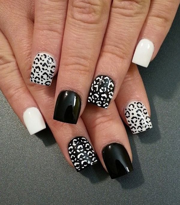 Black and white leopard nail art design. The alternating effect of the prints and backgrounds give this effect a sleek appearance. It's gorgeous and definitely eye catching.