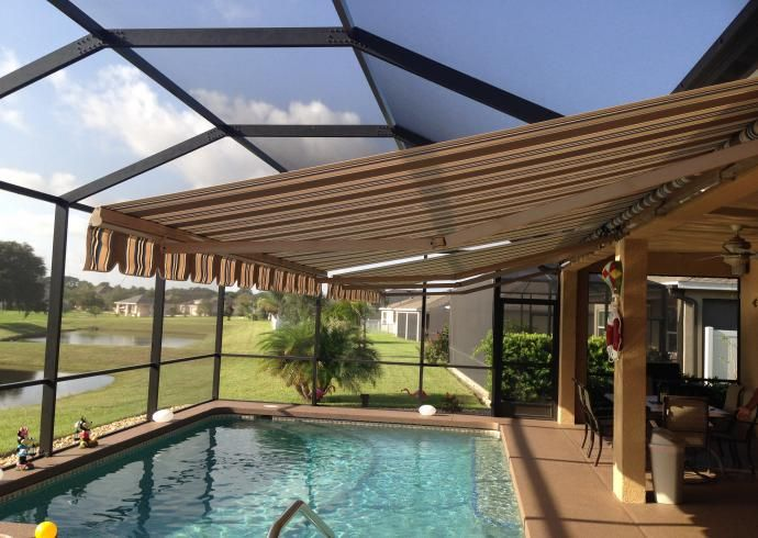 Hurricane Screens And Shutters Retractable Awnings Motorized Screens Shade And Shield Patio Residential Awnings Patio Canopy
