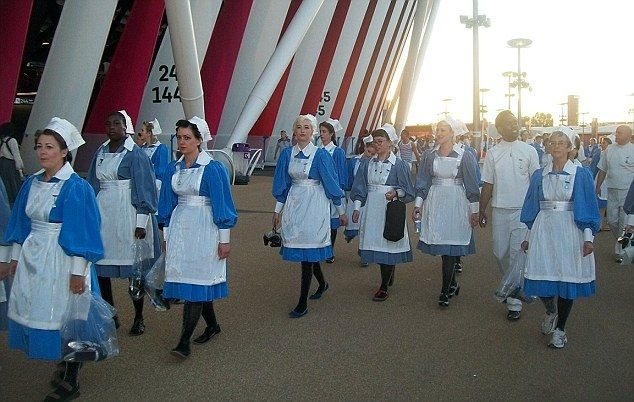 Off to work: This group of nurses was spotted outside the #London stadium by a spectator just before last night's rehearsal for 2012 Summer Olympics opening ceremony.