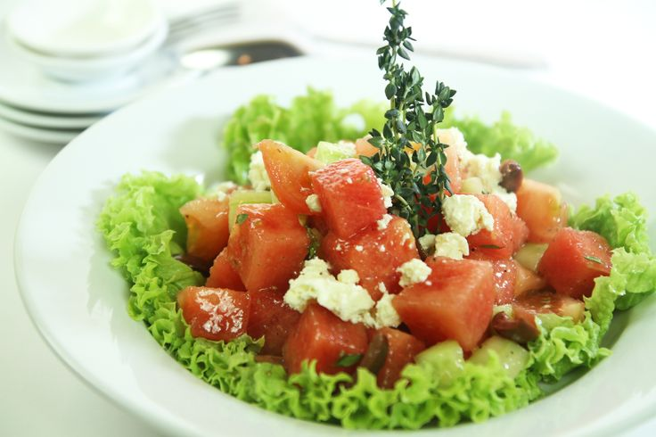 Tomato & Watermelon Salad tossed with cucumber cubes and crumbled light Goat Cheese.