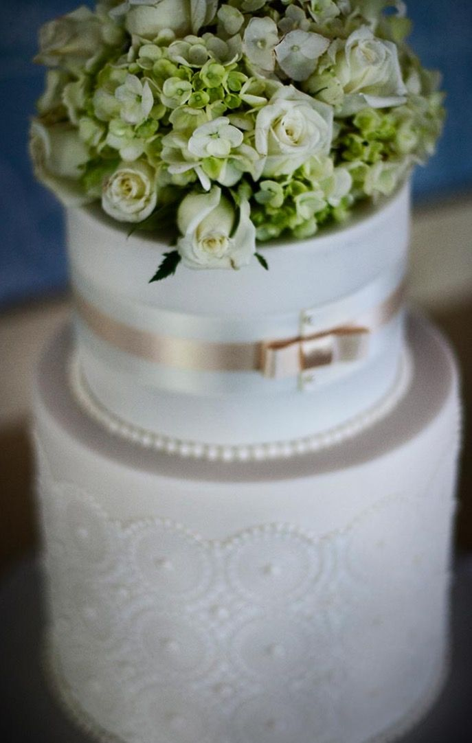 Two tier classic fondant wedding cake with floral topper #wedding #cake #floral #ribbon #white #classic #traditional #pearlescent  Cake: Sweet Art / PC: Akila Berjaoui + Mim Connell