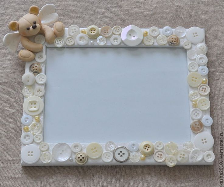 a frame covered in buttons.....with a cute angel bear. love it!