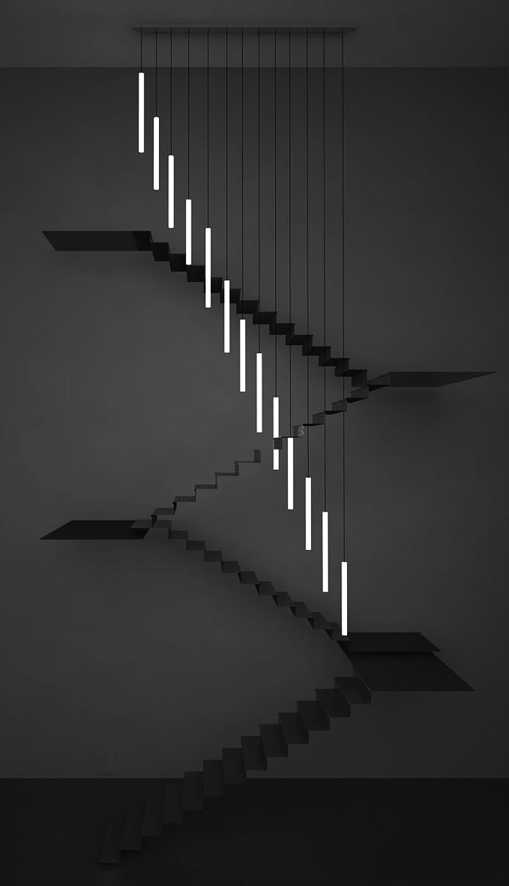bespoke chandelier, consists of 13 corian tubes hung a various lengths to break the staircase geometry.