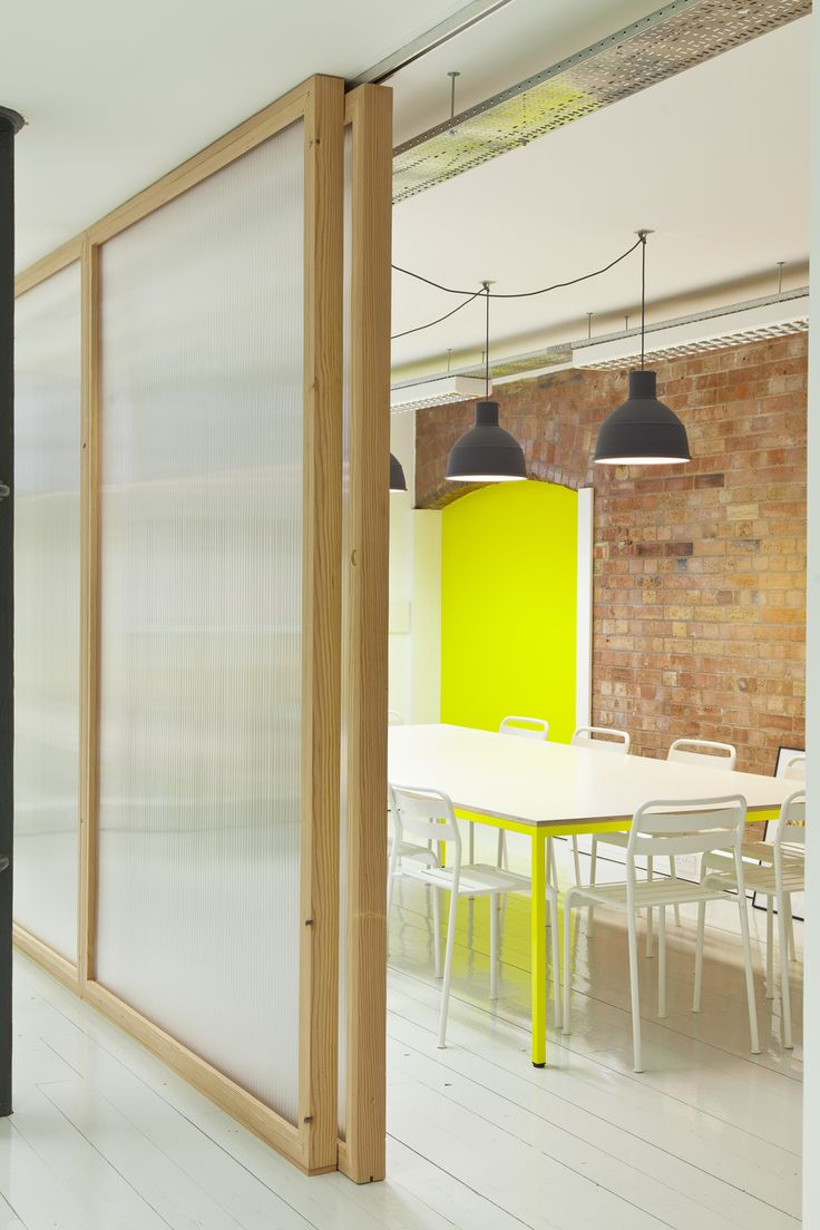 Meeting room with Douglas fir and polycarbonate sliding door