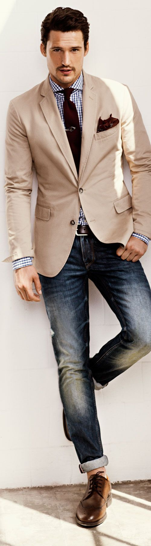 Shop this look for $307:  http://lookastic.com/men/looks/jeans-and-belt-and-brogues-and-pocket-square-and-tie-and-blazer-and-dress-shirt/1529  — Navy Jeans  — Brown Leather Belt  — Brown Leather Brogues  — Burgundy Paisley Pocket Square  — Burgundy Tie  — Beige Blazer  — White and Navy Gingham Dress Shirt