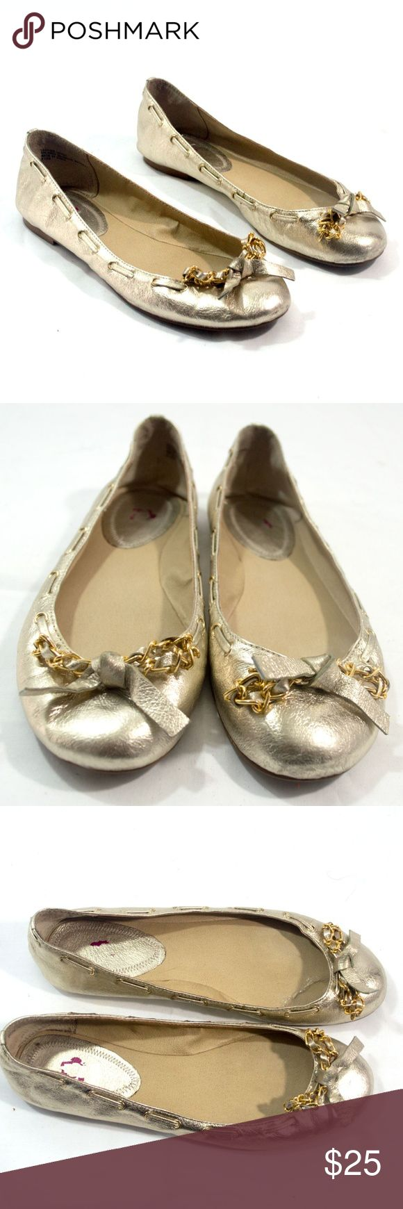 Juicy Couture Light Gold Ballet Flats 8.5 These Pretty Ballet Flats is a light gold color, hard to photograph correct color.  These shoes has decorated gold color chain with bow and light gold color tie going around the top of shoe.  These shoes are gently worn, and good shape, heels and soles are good. Name brand is faded on inside of shoe.  Size:  8.5 Leather Upper Juicy Couture Shoes Flats & Loafers