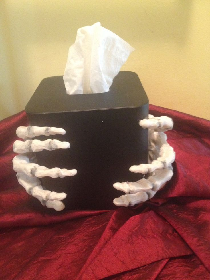 i took a plain tissue holder and hot glued some clay skeleton hands from micheals craft - Davis Halloween Store