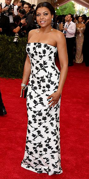 The Most Jaw-Dropping Dresses at the 2015 Met Gala | TARAJI P. HENSON | wearing a strapless white floor-length Balenciaga dress with black floral design (which took 120 hours to hand-bead) and drop-down sculptural silver Balenciaga earrings, plus a Fred Leighton bracelet.