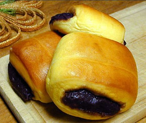 Pan de Coco and Pan de Ube (Filipino soft bread with a sweet coconut or purple yam filling). for homemade purple yam jam, see here: http://pinterest.com/pin/414120128205557140/