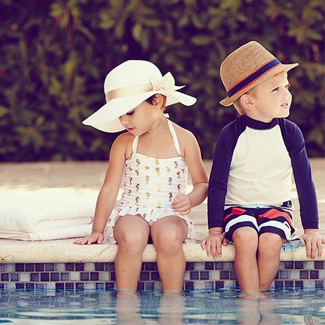 Resort ready in nautical prints and matching sun hats.