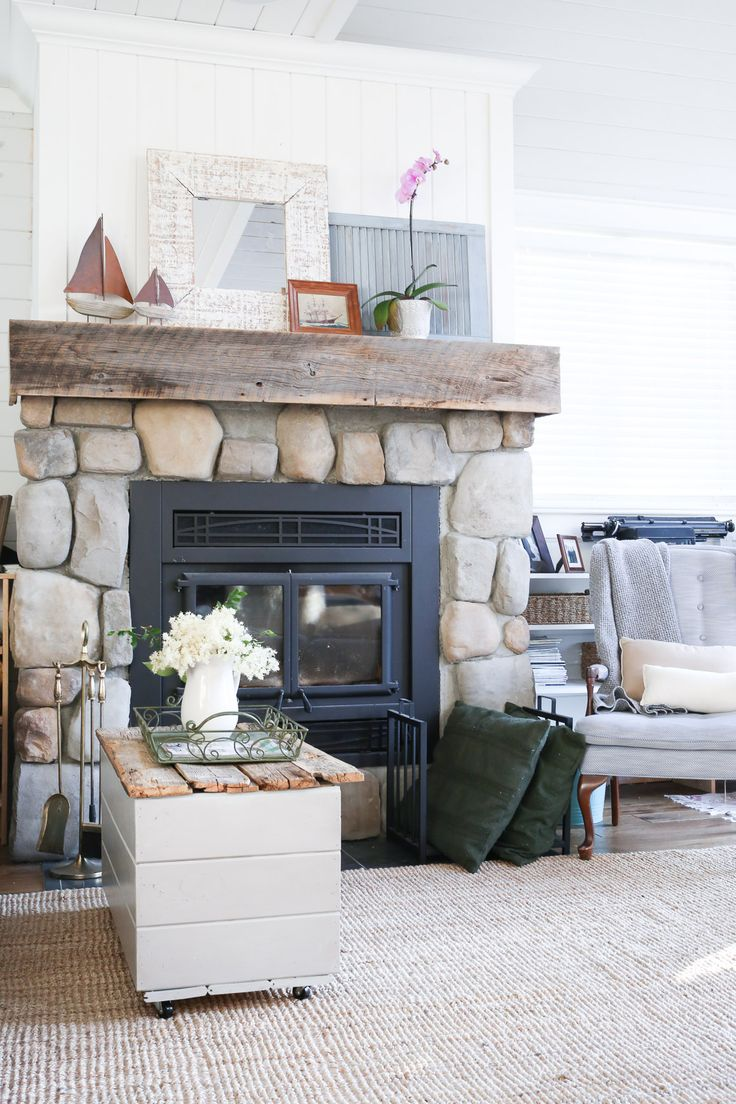 Stone Fireplace Construction With Vertical Shiplap Over