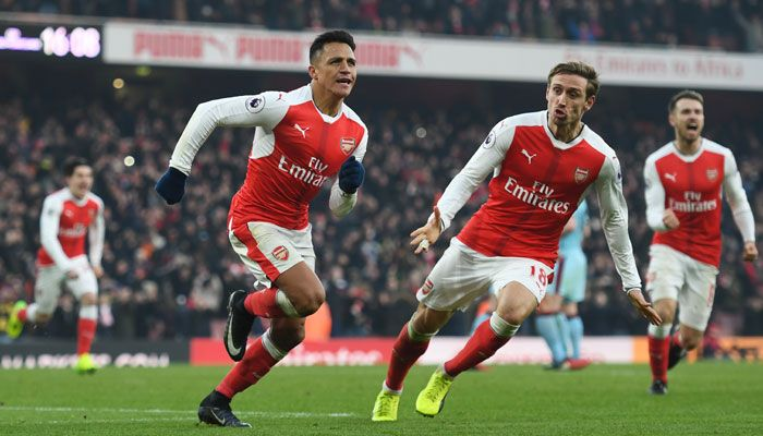 FA Cup: Theo Walcott scores his 100th goal as Arsenal sink plucky Sutton United 2-0 #FCBayern  FA Cup: Theo Walcott scores his 100th goal as Arsenal sink plucky Sutton United 2-0  London: Theo Walcott scored his 100th Arsenal goal as Arsene Wengers side ended non-league minnows Sutton Uniteds FA Cup fairytale with a 2-0 victory in the FA Cup on Monday.  The England forward added to Lucas Perezs opener as Arsenal returned to winning ways following their 5-1 drubbing by Bayern Munich last week…