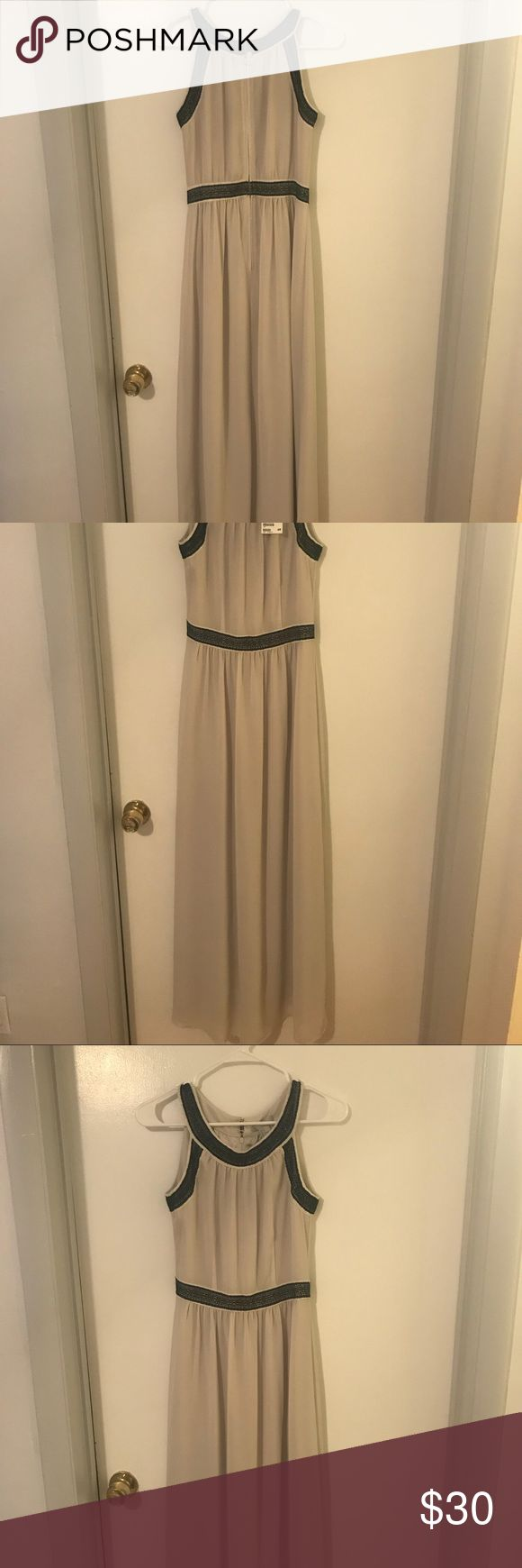 H&M long gown This formal dress flows beautifully and can be worn to a wedding or any formal event. The neck line is high. H&M Dresses Maxi