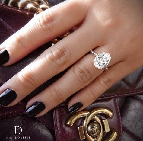 Floating oval diamond engagement ring