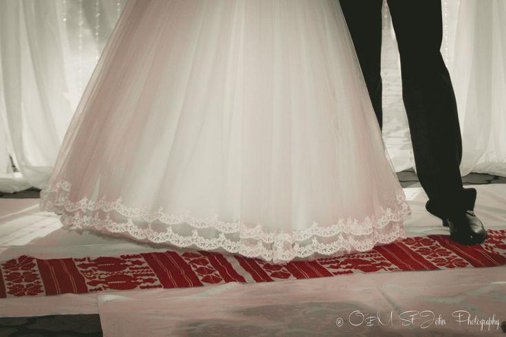 Bride and groom on a traditional rushnyk, Ukrainian Wedding