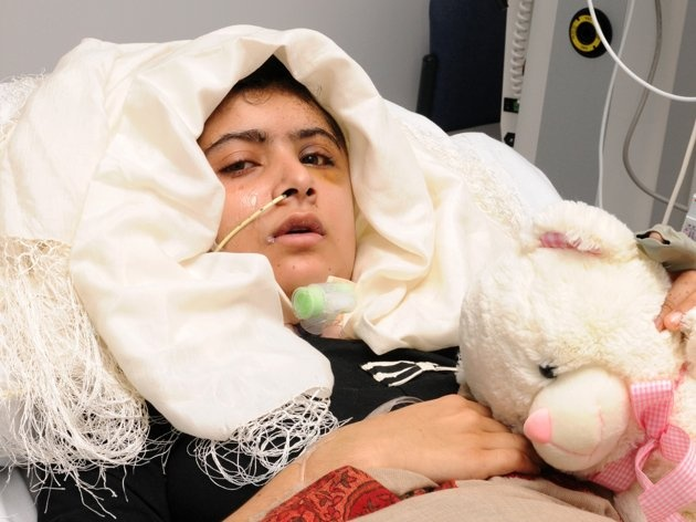 15-year old Pakistani shooting victim Malala Yousufzai, who is recovering in Queen Elizabeth Hospital in Birmingham, England, after being attacked and shot in the head by Taliban gunmen in Pakistan for advocating education for girls. Malala was shot and critically wounded on Oct. 9 as she headed home from school, and was evacuated to the UK. Doctors said she was able to stand with some help and to write. Note that even in a hospital with a brain injury, the girl has to have a headscarf.