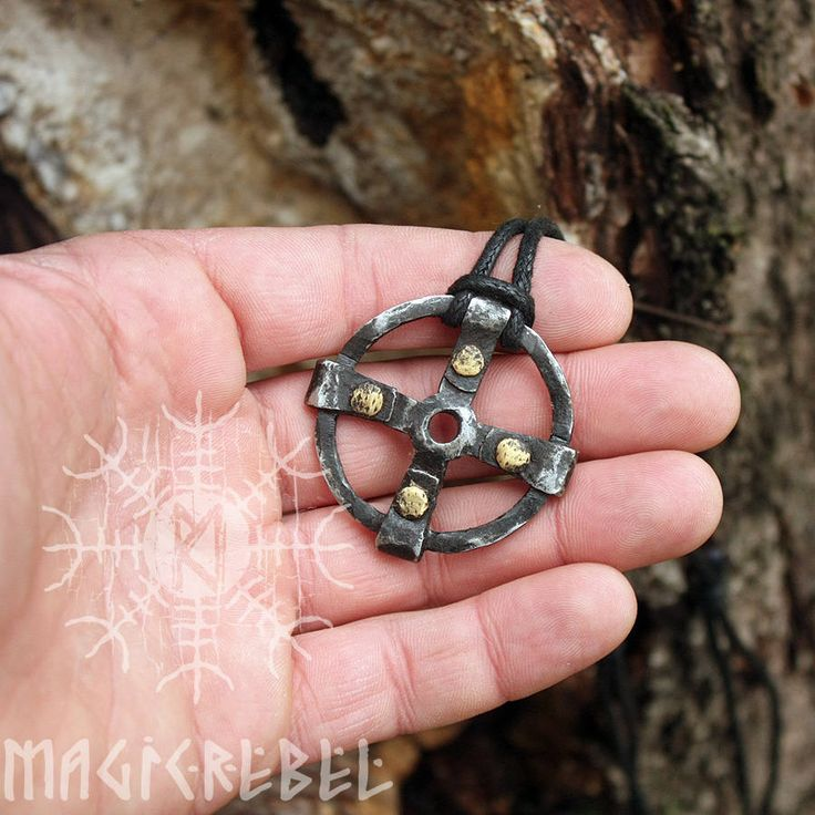 This is a real forged iron twisted handmade Viking style pendant. The pendant is an ancient symbol, the Solar cross, which is probably the oldest religious symbol in the world, appearing in Asian, American, European, and Indian religious art from the dawn of history. Composed of a equal armed cross